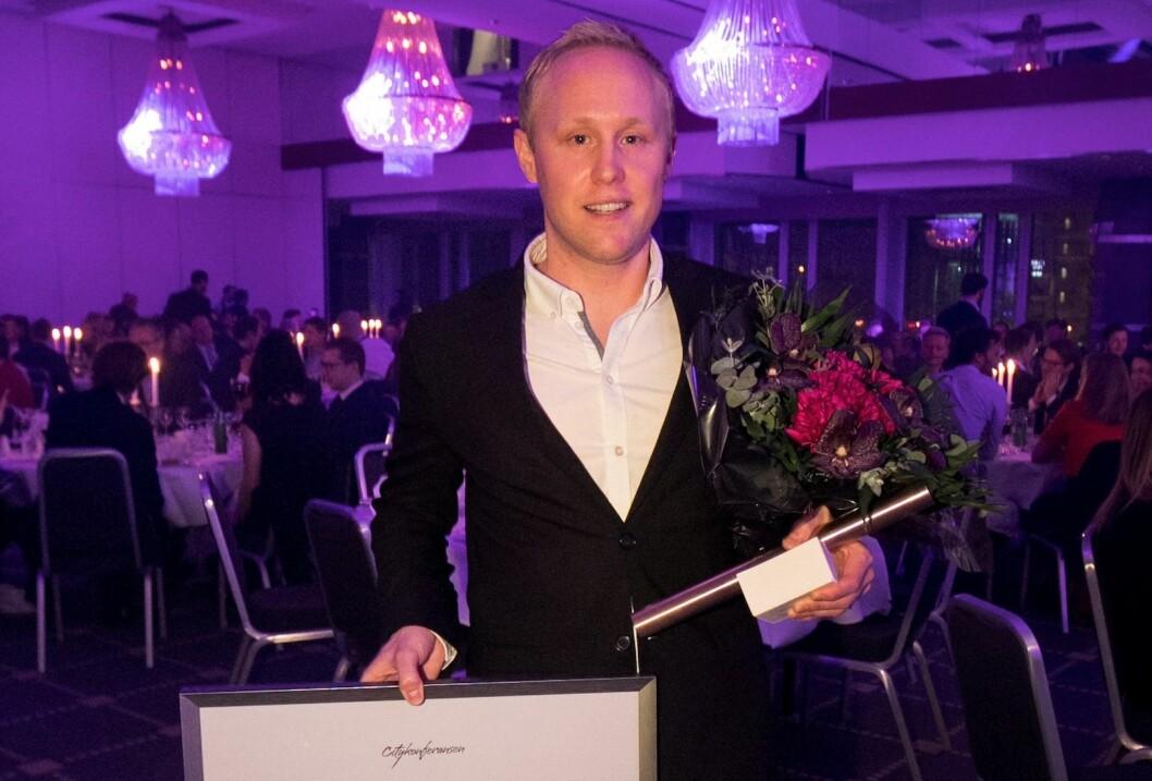 Vinneren av Cityglød 2018 mottar prisen. Foto: Frank Holtschlag.