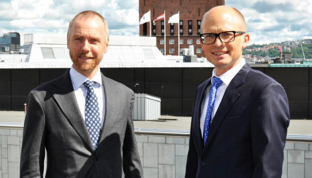 GOD AKTIVITET: Fra 1. juni og frem til sommeren har det vært god aktivitet i transaksjonsmarkedet, sier f.v. Martin Støren og Ditlef Thaulow i Advokatfirmaet Schjødt. Begge tror på en aktiv høst.