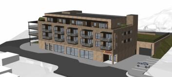 Bygger leiligheter og Extra-butikk
