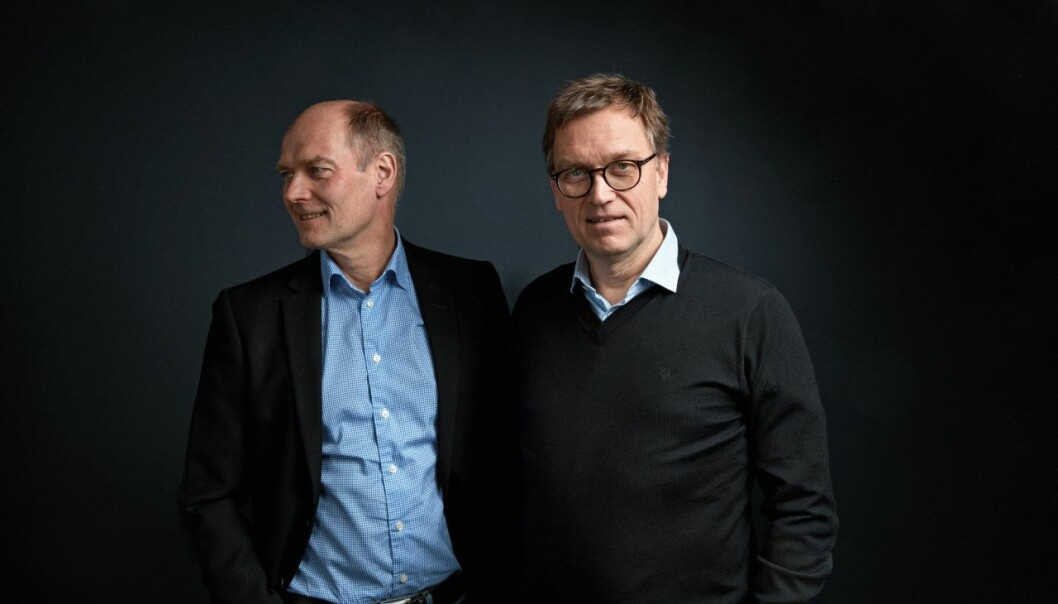 KJØPER: Roger (tv) og Kristian Adolfsen sikrer seg Norges Bank-bygget i Tromsø.